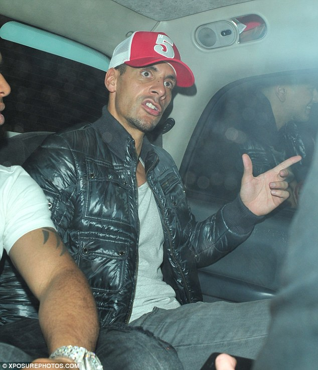 Moving on: The former England international sported a red trucker cap too