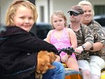 Tough times: Alana 'Honey Boo Boo' Thompson, mother 'Mama' June Shannon and father Mike 'Sugar Bear' Thompson, shown earlier this month, have been coping with sickness and the death of their family dog