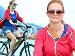 Putting on her daisy dukes! Heather Graham shows some leg on a bicycle tour of Rio de Janeiro as she takes a break from The Hangover Part III promo tour