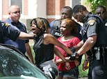 Melee: Cleveland police arrest a woman involved with a fight that broke out at Michael R. White Elementary in Cleveland after a kindergarten graduation