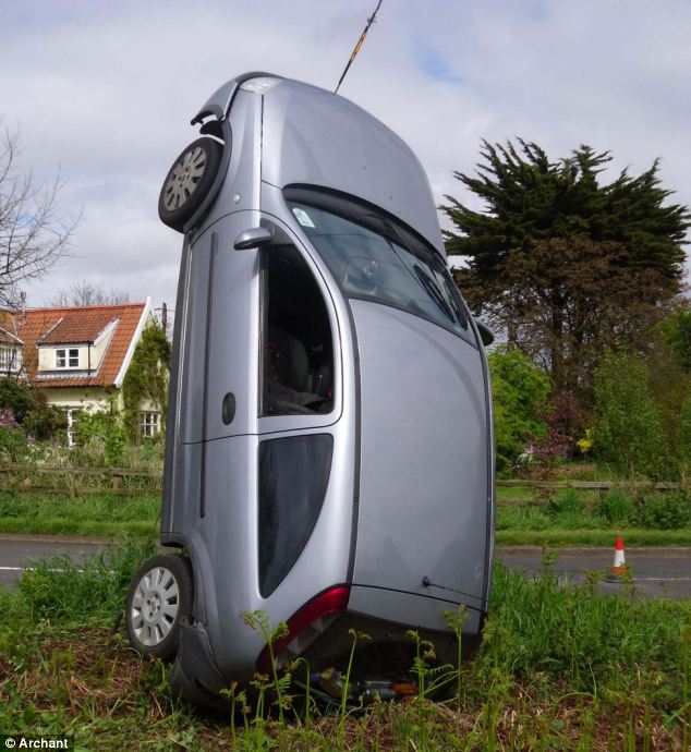 Ready for lift-off: The Vauxhall Corsa, which came off the B1084 in Chillesford, Suffolk, looks like it is about to be launched into the sky