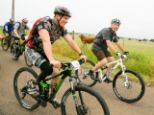 'Bad consequences': Bush, riding with a veteran above, said he knew the injuries many veterans suffer from were part of the 'bad consequences to war'.