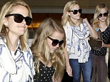 Double take! Reese Witherspoon jets to Paris with lookalike daughter Ava by her side