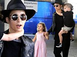 Skipped the fashion show? Nicole Richie goes goth in slouchy black leather and sweats as jets into Los Angeles airport with her children