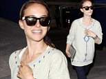 Rough flight? A tired looking Natalie Portman flies in to Los Angeles Airport