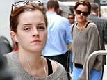 Still an English rose: Emma Watson shows her fresh-faced beauty as she runs errands in New York