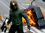 Explosive debut! First glimpse of super villain The Winter Soldier on set of Captain America sequel as he blows up SUV