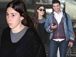 Different off-camera: Zosia Mamet showed off her original style, much unlike her Girls character, as she arrived at Los Angeles International Airport with her boyfriend Evan Jonigkeit on Thursday