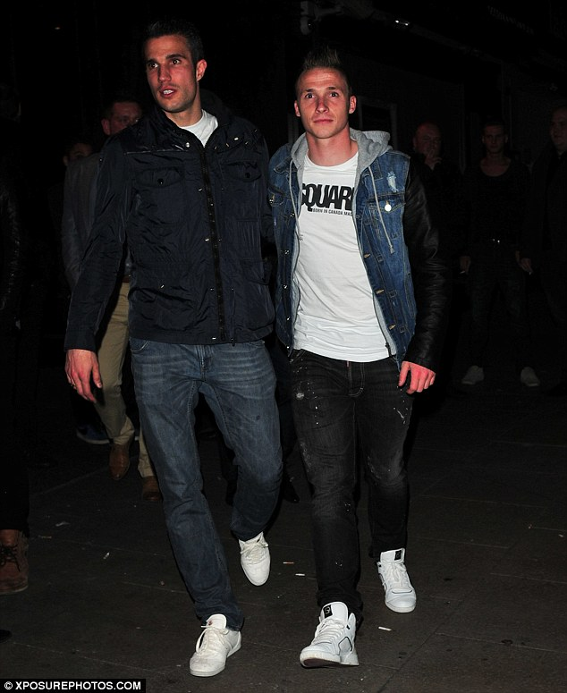 Brothers in arms: Van Persie and his friend were the toast of the town as they headed to the club