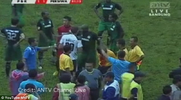 Hold up: The match stopped for 15 minutes before a replacement referee came on and sent Rumaropen off