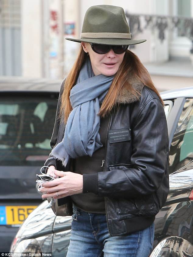 Flying high: Carla wore a leather flight jacket of the French Acrobatic Patrol with a small patch bearing her name