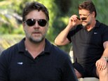 Fancy a coffee, mate? Russell Crowe dons tight shorts as he goes for a java with friend in Beverly Hills