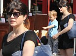 The fountain of youth! Selma Blair's boy Arthur is fascinated by water feature during outing in Los Angeles