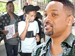 Smiling through the heartbreak! Will Smith grins on outing with Jaden... as critics savage their new film After Earth