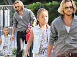 Hand in hand! Gabriel Aubry plays doting father as Nahla sports her flower power in a summer frock