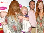 Starting them young! James Van Der Beek and wife Kimberly show off their babies' string Kabbalah bracelets