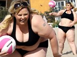 Ajay Rochester displays her obese bikini body while attempting to play volleyball