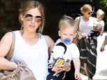 Hilary Duff and husband Mike Comrie go out with son Luca
