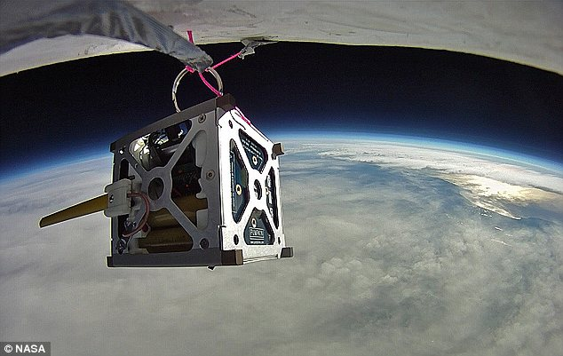 High-flying: The PhoneSat, pictured during a test flight, will be the cheapest and easiest-to-construct satellite to go into orbit