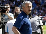 Snappers: Mourinho was surrounded by photographers on the touchline on Saturday at the Bernabeu
