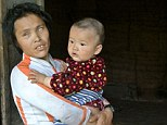 Desperate measures: Du Xiurong, pictured with her grandson