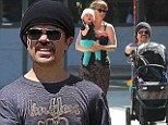 Baby love! Peter Dinklage and wife Erica take their precious daughter Zelig on a sunny stroll