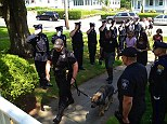 Fellow Massachusetts police officers pay tribute to Kaiser, a German Shepard in the K-9 unit suffering from kidney disease, as he is walked into the pet hospital to be put down