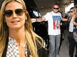 Doubly duty! Heidi Klum's beau Martin Kristen proves that he's still her number-one bodyguard as protects her at LAX