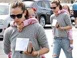 Get a grip! Jennifer Garner treats Seraphina to a piggyback ride on mother- daughter grocery run