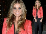 Lady in red: Carmen Electra keeps it casual but chic as she hits the town for a birthday dinner