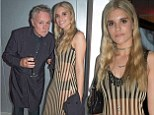 Living up to her name! Tigerlily Taylor wears a daring striped dress for trip to the opera with her father queen guitarist Roger Taylor