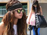 Stocking up for summer! Selena Gomez emerges from a shopping day with bags that nearly weigh her over