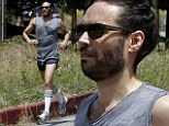 Running a marathon? Russell Brand turns a run in to a comedy wearing short shorts and knee socks