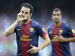 Sealed with a kiss: Cesc Fabregas played in Barcelona's 4-1 thumping over Manuel Pellegrini's Malaga