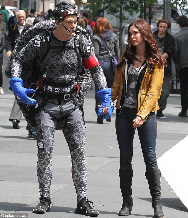 Lights, camera, action: Megan hung onto her Turtle co-star's hand, who was fully suited up in a CGI costume