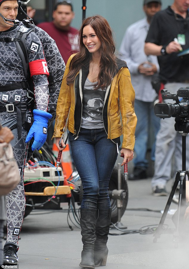 All cheered up: Happier than she has been lately on set, the brunette bombshell beamed next to Alan
