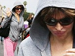 Something to hide? Botox fan Lisa Rinna reveals a puffier trout pout as she steps out undercover in a hooded sweatshirt