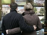 YOUNG FIRST-TIME BUYERS LOOKING AT PROPERTIES FOR SALE.