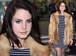 Surely it's not that cold! Lana Del Rey throws on a fur coat and heavy black boots as she steps out in Warsaw