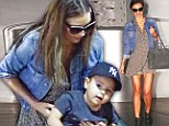 Getting Flynn some camera training? Miranda Kerr brings along her son as she heads off to New York City photo shoot
