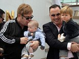 Proud dads: Sir Elton John and David Furnish were seen arriving in Venice, Italy, on Wednesday as they embarked upon their holiday with sons Zachary, two, and Elijah, four months