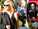 Boys will be boys! Gwen Stefani indulges her sons Zuma and Kingston with rides on the wild side during family's day out