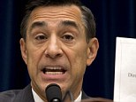 House Oversight Committee Chairman Rep. Darrell Issa, R-Calif. holds up a document as he speaks to IRS official Lois Lerner on Capitol Hill in Washington, Wednesday, May 22