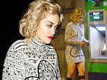 Tired right now: Rita Ora looks worn out as she makes late night cashpoint visit after hectic performance at Chime For Change