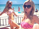 She's a working girl! Paris Hilton is a 'proud designer' as she struts her stuff in a bikini on a Hawaiian beach during a campaign for her new clothing line