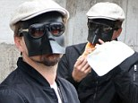 The return of the man with the iron mask! Leonardo DiCaprio goes unnoticed in Venice as he slips on disguise to eat pizza