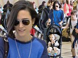 Supermom! Jennifer Connelly takes charge as she jets out of LAX with Paul Bettany and her three children