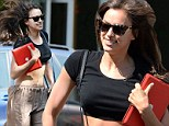Everyone moves faster in Manhattan! Irina Shayk shows off her toned tummy in short-cropped top as she runs to grab a bite