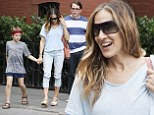 With her main men! Sarah Jessica Parker stops to enjoy some music with Matthew Broderick and son James Wilkie