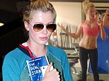 How low can you go? Ireland Baldwin shows her body confidence as she works out in a pair of very low-cut leggings